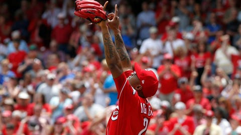 Scooter ends HR spree, but Reds rally to beat Cardinals