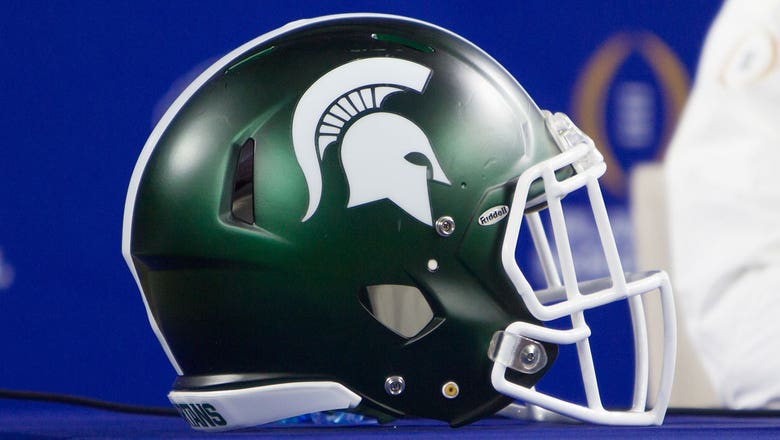 Arrest warrants issued for 3 Michigan State football players charged with sexual assault